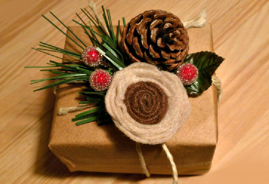 Fresh-leaf-rounded-red-flower-brown-pine-and-brown-rose-from-flannel-in-tune-with-the-wapping-paper-for-christmas-gift-idea
